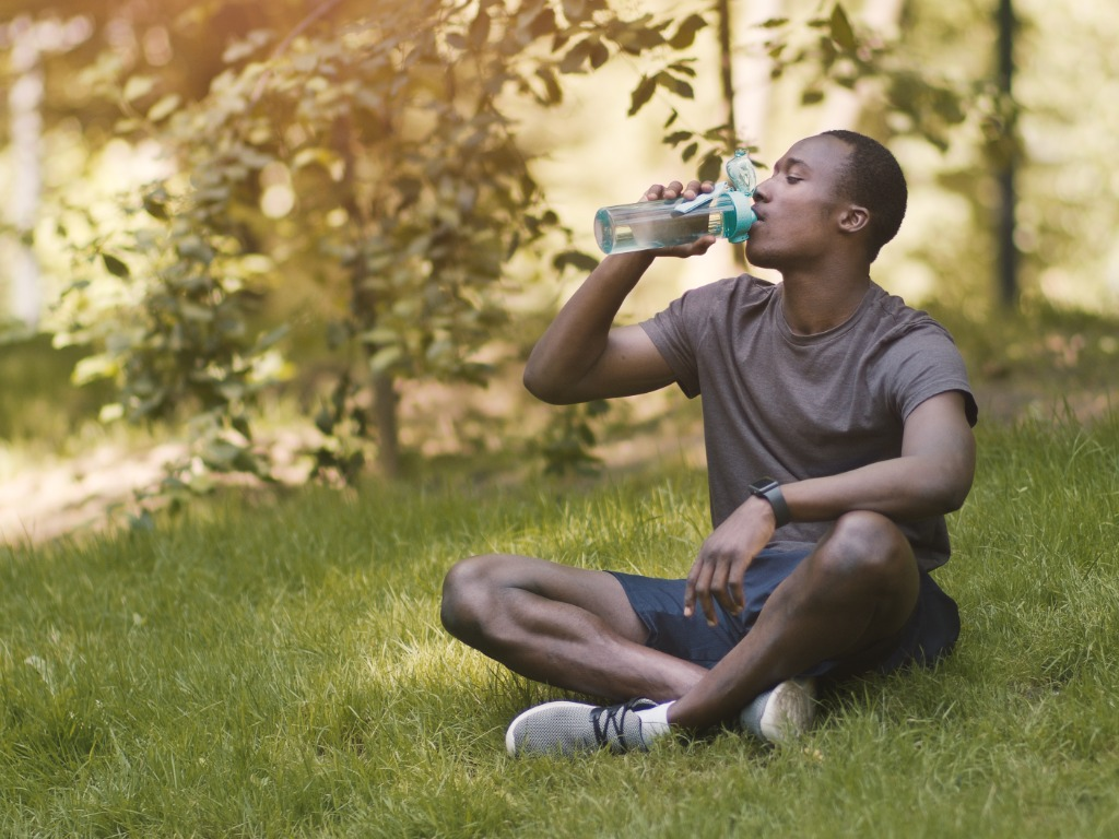 Man Staying Hydrated with Help From Family Pharmacy